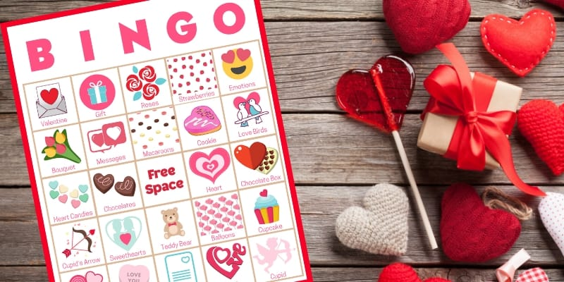 Valentines Day party game perfect for any group! Get 40 printable bingo game cards now - a perfect holiday theme for a Valentines Day party with kids or Valentines Day party for adults or office parties. With words and pictures and instructions for how to play, these bingo cards you'll find the perfect games & ideas for your Valentines Day party!
